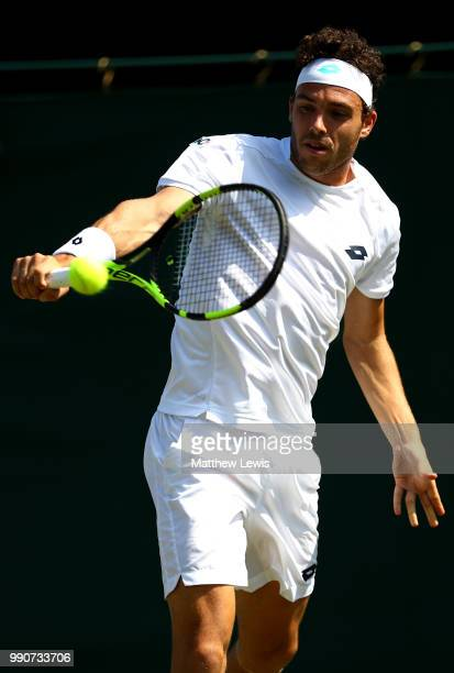 Marco Cecchinato of Italy returns against Alex De Minaur of Australia during their Men's Singles first round match on day two of the Wimbledon Lawn...