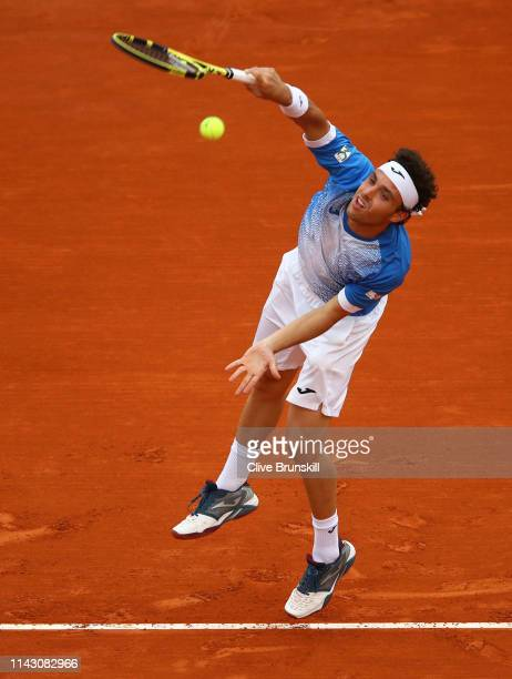 Marco Cecchinato of Italy serves against Stan Wawrinka of Switzerland in their second round match during day 3 of the Rolex MonteCarlo Masters at...