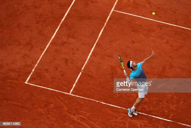Marco Cecchinato of Italy serves during the mens singles fourth round match against David Goffin of Belgium during day eight of the 2018 French Open...