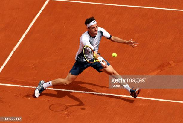 Marco Cechinato of Italy volleys in his mens singles first round match against Nicolas Mahut of France during Day one of the 2019 French Open at...