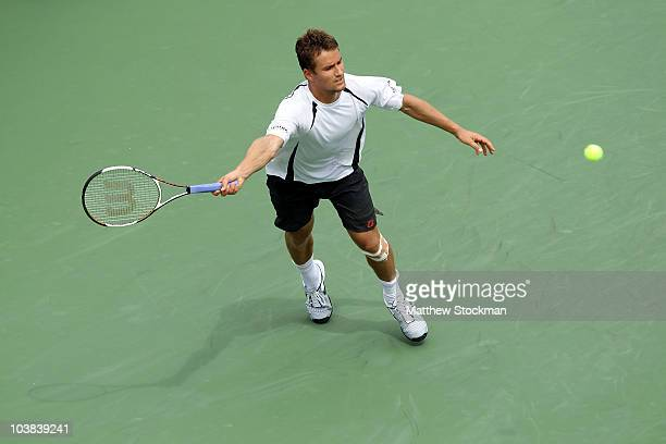 Marco Chiudinelli of Switzerland hits a return against John Isner of the United States during his men's singles match on day five of the 2010 U.S....
