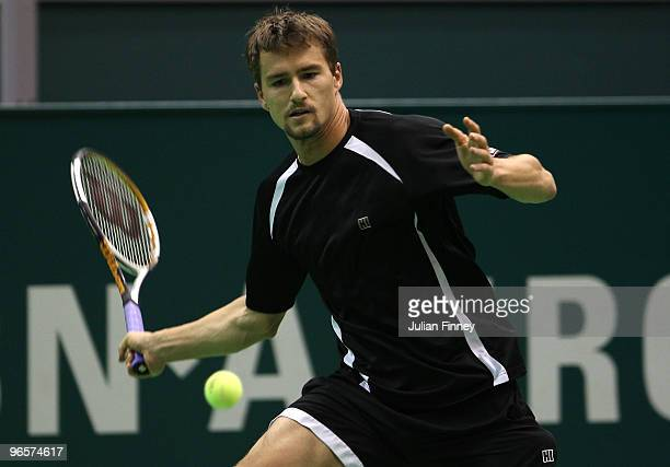 Marco Chiudinelli of Switzerland in action in his match against Novak Djokovic of Serbia during day four of the ABN AMBRO World Tennis Tournament on...