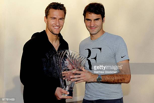 Marco Chiudinelli of Switzerland is presented the Comeback Player of the Year award by Roger Federer of Switzerland during the BNP Paribas Open on...