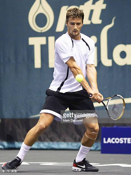 Marco Chiudinelli of Switzerland plays a forehand during his match against Marat Safin of Russia during day six of the 2009 Thailand Open at Impact...