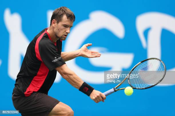 Marco Chiudinelli of Switzerland returns a shot during the match against Taylor Fritz of the United States during Qualifying second round of 2017 ATP...