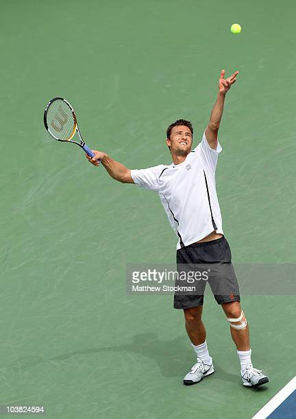 Marco Chiudinelli of Switzerland serves against John Isner of the United States during his men's singles match on day five of the 2010 U.S. Open at...