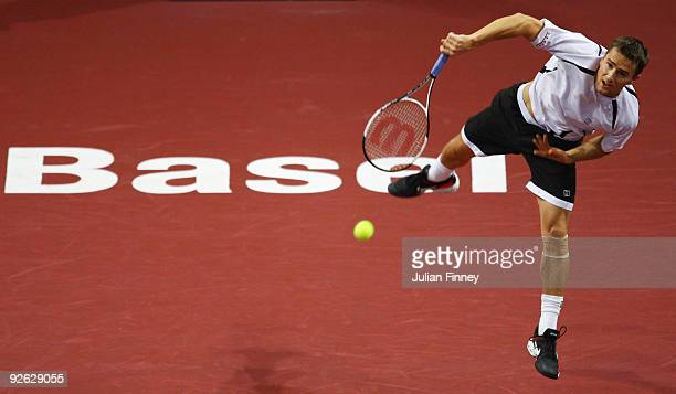 Marco Chiudinelli of Switzerland serves to Philipp Kohlschreiber of Germany during Day Two of the Davidoff Swiss Indoors Tennis at St Jakobshalle on...