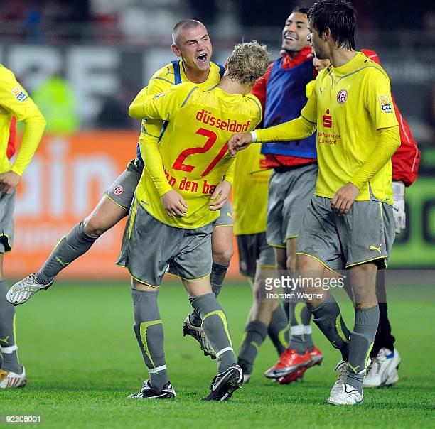 Marco Christ and his team mate Johannes van den Bergh of Duesseldorf celebrate after winning the Second Bundesliga match between 1. FC Kaiserslautern...