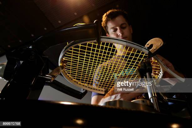 Marco Comuzzo restrings racquets during the Hopman Cup 2018 at Perth Arena on December 31 2017 in Perth Australia