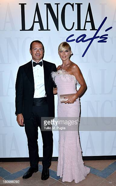 Marco Costantini and Matilde Brandi attend the 69th Venice Film Festival Opening AfterDinner Party at Lancia Cafe on August 29 2012 in Venice Italy