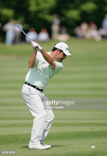 Marco Crespi of Italy plays his approach shot on the third hole during the final round of The Telecom Italian Open Golf at The Castello Di Tolcinasco...