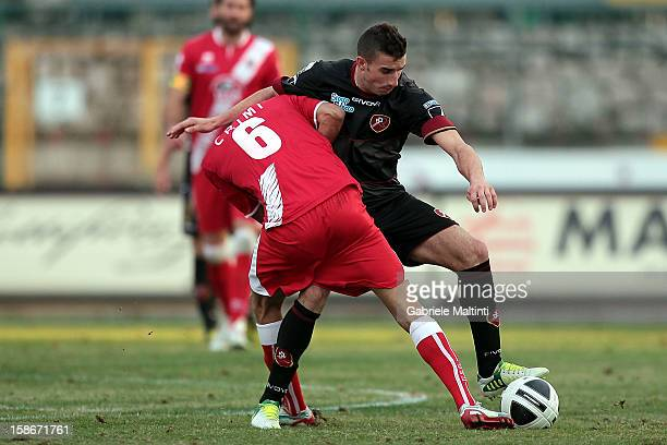 Marco Crimi of US Grosseto Fc battles for the ball with Antonio Barilla' of Reggina Calcio during the Serie B match between US Grosseto and Reggina...