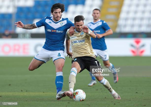 Marco D Alessandro of Spal is challenged by Sandro Tonali of Brescia Calcio during the Serie A match between Brescia Calcio and SPAL at Stadio Mario...