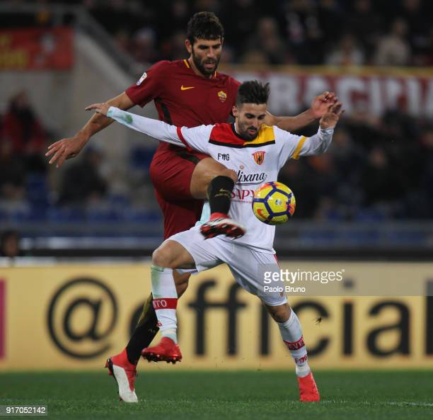 Marco D'Alessandro of Benevento Calcio competes for the ball with Federico Fazio of AS Roma during the serie A match between AS Roma and Benevento...