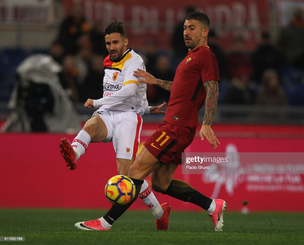 Marco D'Alessandro of Benevento Calcio competes for the ball with Aleksandar Kolarov of AS Roma during the serie A match between AS Roma and Benevento Calcio at Stadio Olimpico on February 11, 2018 in Rome, Italy.