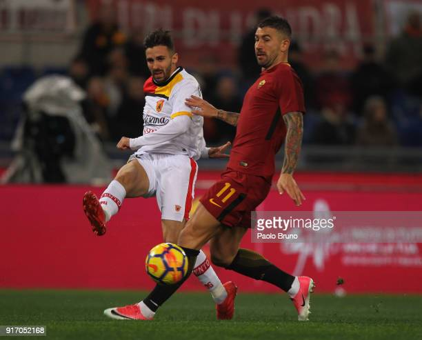 Marco D'Alessandro of Benevento Calcio competes for the ball with Aleksandar Kolarov of AS Roma during the serie A match between AS Roma and...