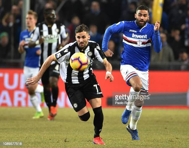 Marco D'Alessandro of Udinese and Gregoire Defrel of Sampdoria in action during the Serie A match between UC Sampdoria and Udinese at Stadio Luigi...