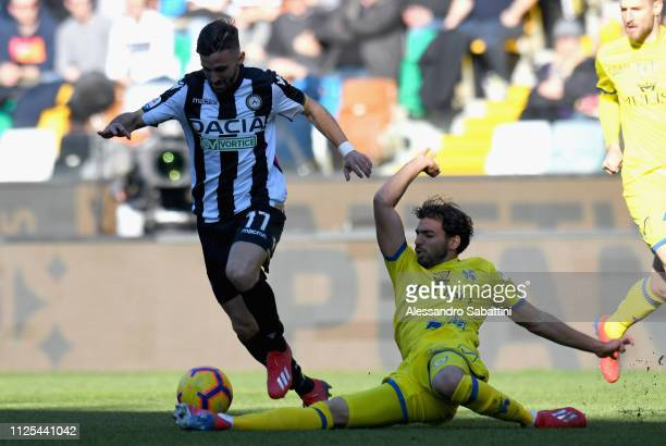 Marco D'Alessandro of Udinese Calcio competes for the ball with Medhi Leris of Chievo Verona during the Serie A match between Udinese and Chievo at...