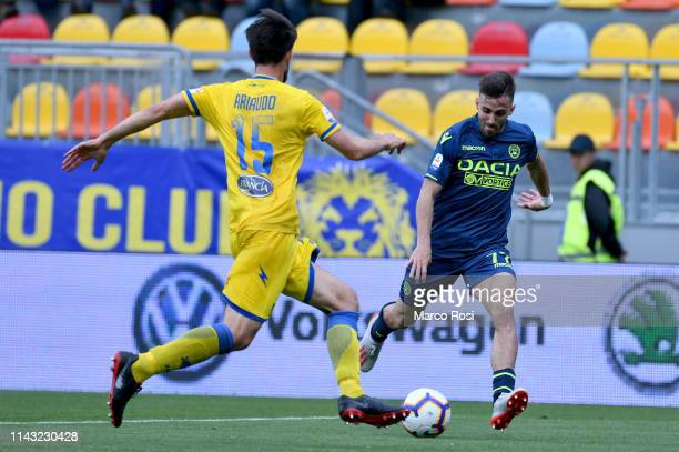 Marco D'Alessandro of Udinese compete for the ball with Lorenzo Ariaudo of Frosinone during the Serie A match between Frosinone Calcio and Udinese at...