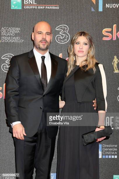 Marco D'Amore and Daniela Maiorana walk the red carpet of the 61. David Di Donatello on March 27, 2017 in Rome, Italy.