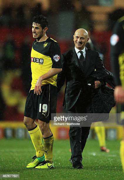 Marco Davide Faraoni of Watford and Giuseppe Sannino the Watford manager celebrate their team's 20 victory during the Budweiser FA Cup third round...