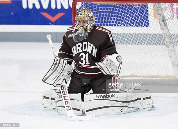Marco De Fillippo of the Brown University Bears makes a save in warmups before NCAA hockey action against the Providence College Friars at the...