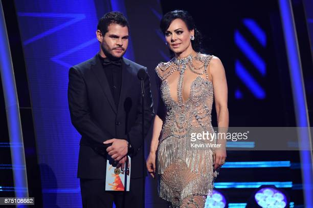 Marco de la O and Maribel Guardia speak onstage at the 18th Annual Latin Grammy Awards at MGM Grand Garden Arena on November 16 2017 in Las Vegas...