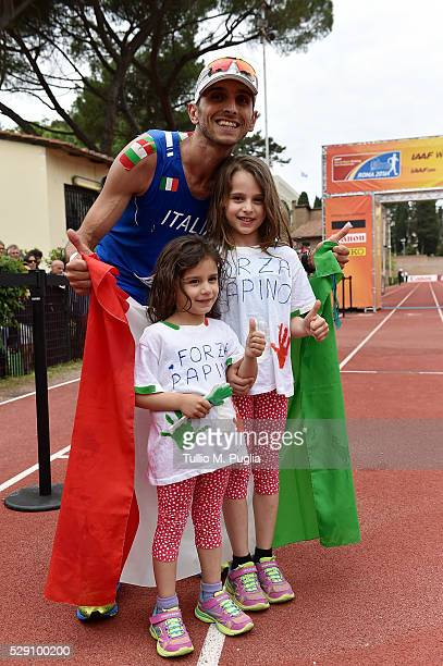 Marco De Luca celebrates with his doughters after crossing the finish line celebrates in the the 50KM Race Walk at IAAF Race Walking Team Campionship...