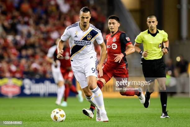 Marco Delgado of Toronto FC tries to stop Zlatan Ibrahimovic of LA Galaxy during the MLS regular season match between Toronto FC and LA Galaxy on...