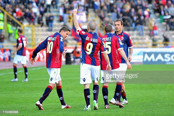 Marco Di Vaio, captain of Bologna celebrates his opening goal with Gaston Ramirez and team-mates during the Serie A match between Bologna FC and...