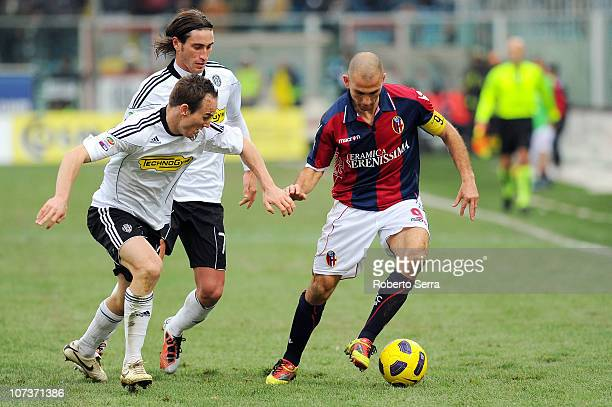 Marco Di Vaio captain of Bologna competes with Steve Von Bergen of Cesena during the Serie A match between Cesena and Bologna at Dino Manuzzi Stadium...