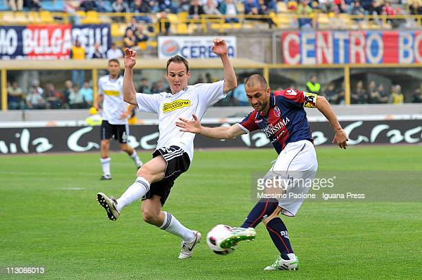 Marco Di Vaio captain of Bologna competes with Steve Von Bergen of Cesena during the Serie A match between Bologna FC and AC Cesena at Stadio Renato...