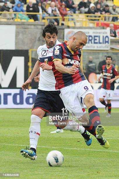 Marco Di Vaio of Bologna FC kicks on goal as Kakha Kaladze of Genoa CFC get a tackle during the Serie A match between Bologna FC and Genoa CFC at...