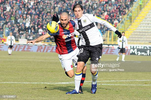 Marco Di Vaio of Bologna FC vies with Gabriel Paletta of Parma FC during the Serie A match between Bologna FC and Parma FC at Stadio Renato Dall'Ara...