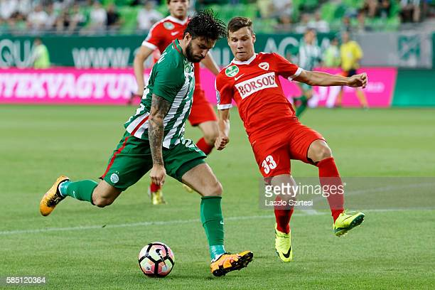 Marco Djuricin of Ferencvarosi TC shots on goal next to Milan Nemes of DVTK during the Hungarian OTP Bank Liga match between Ferencvarosi TC and DVTK...