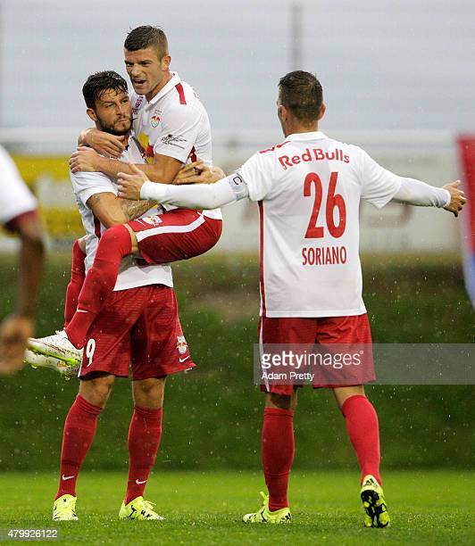 Marco Djuricin of Red Bull is congratulated by team mate Christoph Leitgeb after scoring a goal during the friendly match between Red Bull Salzburg...
