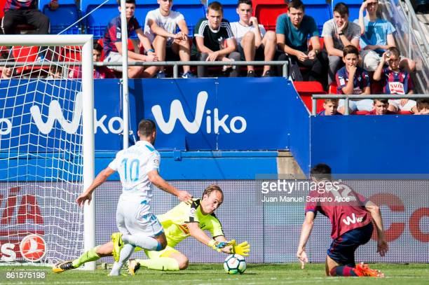 Marco Dmitrovic of SD Eibar duels for the ball with Florin Andone of RC Deportivo La Coruna during the La Liga match between SD Eibar and RC...