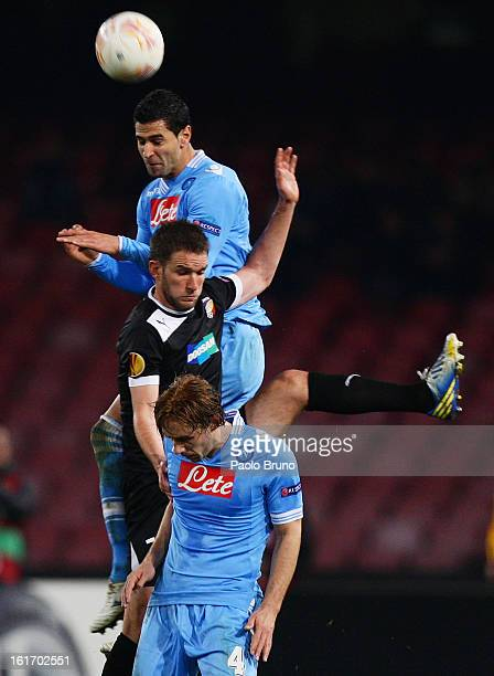 Marco Donadel and Miguel Britos of SSC Napoli compete for the ball with Marek Bakos of FC Viktoria Plzen during the UEFA Europa League Round of 32...