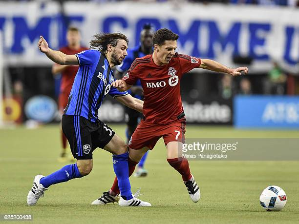 Marco Donadel of the Montreal Impact and Will Johnson of the Toronto FC battle for the ball during leg one of the MLS Eastern Conference finals at...
