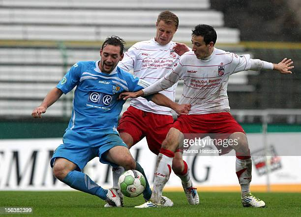 Marco Engelhardt and Kevin Moehwald of Erfurt challenges Maik Kegel of Chemnitz during the Third League match between RW Erfurt and Chemnitzer FC at...