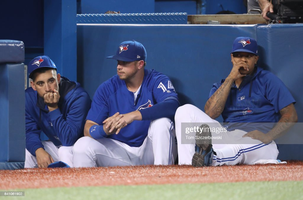 Marco Estrada #25, Justin Smoak #14 and Marcus Stroman #6 of the Toronto Blue Jays look on during a loss in the ninth inning against the Boston Red Sox at Rogers Centre on August 30, 2017 in Toronto, Canada.