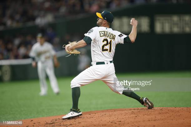 Marco Estrada of the Oakland Athletics pitches during the game against the Seattle Mariners at the Tokyo Dome on March 21, 2019 in Tokyo, Japan. The...