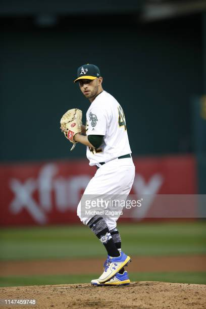 Marco Estrada of the Oakland Athletics pitches during the game against the Houston Astros at the Oakland-Alameda County Coliseum on April 16, 2019 in...