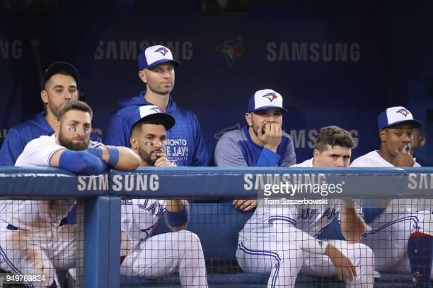 Marco Estrada of the Toronto Blue Jays and Kevin Pillar and Devon Travis and JA Happ and Jaime Garcia and Aledmys Diaz and Curtis Granderson look on...