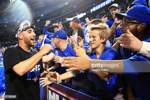 Marco Estrada of the Toronto Blue Jays celebrates with fans after the Toronto Blue Jays defeated the Toronto Blue Jays 76 for game three of the...