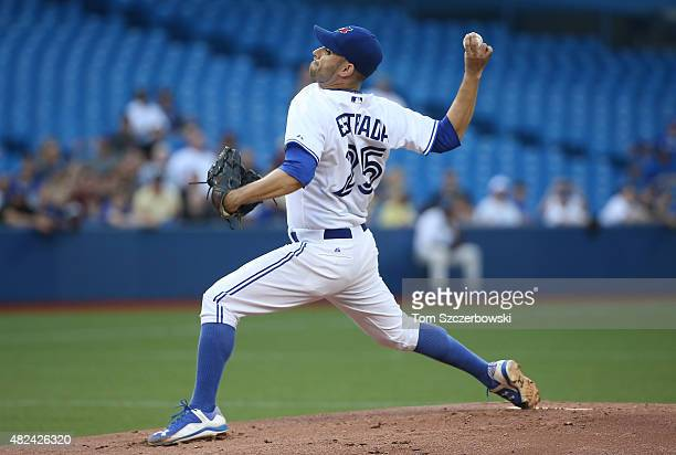 Marco Estrada of the Toronto Blue Jays delivers a pitch in the first inning during MLB game action against the Kansas City Royals on July 30, 2015 at...