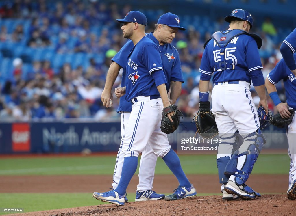 Marco Estrada #25 of the Toronto Blue Jays exits the game as he is relieved by manager John Gibbons #5 in the fourth inning during MLB game action against the Tampa Bay Rays at Rogers Centre on June 13, 2017 in Toronto, Canada.