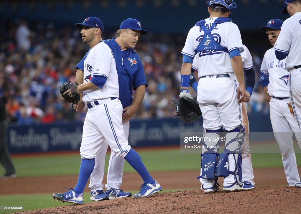 Marco Estrada #25 of the Toronto Blue Jays exits the game as he is relieved by manager John Gibbons #5 in the fifth inning during MLB game action against the Boston Red Sox at Rogers Centre on June 30, 2017 in Toronto, Canada.