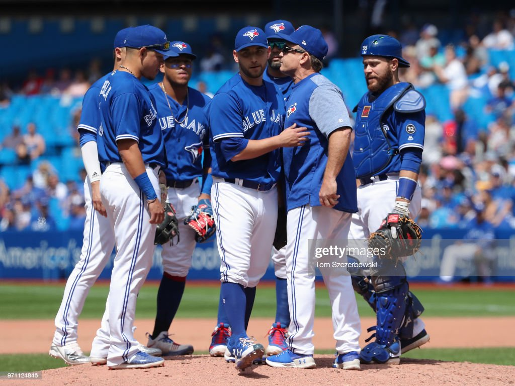 Marco Estrada #25 of the Toronto Blue Jays exits the game as he is relieved by manager John Gibbons #5 in the seventh inning during MLB game action against the Baltimore Orioles at Rogers Centre on June 10, 2018 in Toronto, Canada.