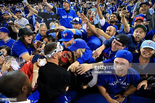 Marco Estrada of the Toronto Blue Jays is swarmed by fans after the Toronto Blue Jays defeated the Toronto Blue Jays 76 for game three of the...